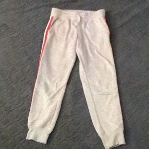 Gray sweatpants with stripes down the sides